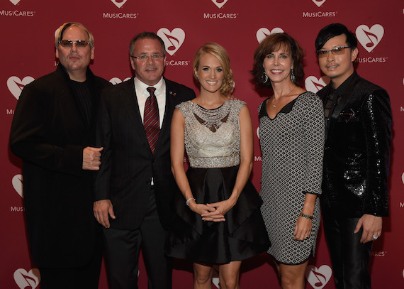 Pictured (L-R): Johnathon Arndt;  Pete Fisher, Vice President/General Manger Grand Ole Opry and MusiCares® Board member; seven-time GRAMMY® winner Carrie Underwood; Debbie Carroll, Senior Executive Director MusiCares; Newman Arndt. Photo: Rick Diamond/The Recording Academy