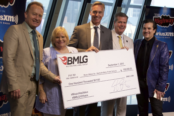 Pictured (L-R): Dr. Jay Steele (Chief Academic Officer), Dr. Nola Jones (Coordinator of Visual and Performing Arts), Chris Henson (Interim Director of Schools), Mayor Karl Dean and BMLG's Scott Borchetta with $100,000 donation to Music Makes Us. Photo: Lance Goodman