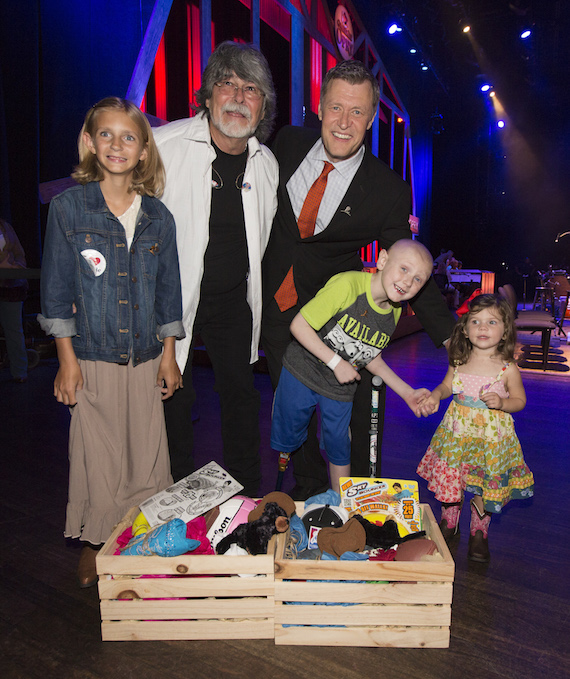 Country Cares for St. Jude Kids® co-founder Randy Owen and Opry announcer Bill Cody with St. Jude patients Ally, Mack and Harper (l to r) onstage at the Opry's celebration of Country Cares for St. Jude Kids.