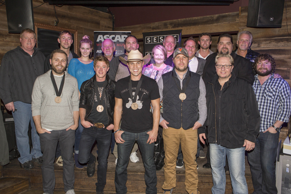 Pictured (L-R) Front: Co-writer Zach Crowell, Co-writer Adam Sanders, Dustin Lynch, Co-writer Jaron Boyer and Producer Mickey Jack Cones. Back: ASCAP's Mike Sistad, Tape Room Music's Ashley Gorley, ASCAP's Beth Brinker, BBR's Benny Brown, peermusic's Michael Knox and Kim Wiggins, Big Yellow Dog's Kerry O'Neil, BBR's Jon Loba, Warner Chappell's Ryan Beuschel, SESAC's Tim Fink, and Combustion's Chris Farren, and Chris Van Belkom. Photo: Ed Rode