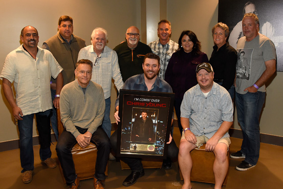 "Sony Music Nashville presented Chris Young with a plaque celebrating the recent RIAA Gold certification of his current single, ""I'm Comin' Over."" Back Row (L-R): Paul Barnabee (SVP, Marketing, Sony Music Nashville), Jim Catino (VP, A&R, Sony Music Nashville), Bill Simmons (Fitzgerald Hartley), Larry Fitzgerald (Fitzgerald Hartley), Steve Hodges (EVP, Promotions & Artist Development, Sony Music Nashville), Caryl Healey (VP, Sales, Sony Music Nashville), Angie Magill (VP, Legal & Business Affairs, Sony Music Nashville), Keith Gale (SVP/National Promotion, RCA) Front Row (L-R): Randy Goodman (Chairman & CEO, Sony Music Nashville), Young, Josh Easler (Director/National Promotion, RCA) Photo: Rick Diamond/Getty Images for Sony Music Nashville"