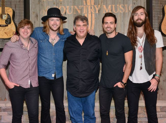 A Thousand Horses with Academy CEO, Bob Romeo. Photo: Michel Bourquard/Courtesy of the Academy of Country Music