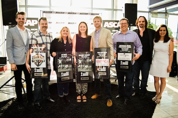 """Girl Crush"" wins Song of the Year. Pictured (L-R): MusicRow's Eric T. Parker, Warner/Chappell's Ben Vaughn, ""Girl Crush"" songwriters Liz Rose and Hillary Lindsey, BMG's Kos Weaver, Universal Music Publishing Group's Kent Earls, and MusicRow's Sherod Robertson and Sarah Skates. Not pictured: co-writer Lori McKenna. Photo: Bev Moser."
