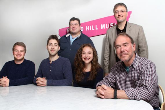 "Pictured (L-R, Seated): Josh Saxe, Assoc. Dir. A&R, Round Hill; Marc ""Schmarx"" Schneider; Savannah ""Savvy"" Giersch; Mark Brown, VP / GM Round Hill, Nashville. (Standing): Eric Griffin, attorney; Matthew Beckett, attorney"