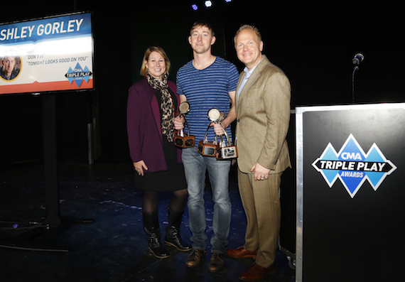 Pictured (L-R): Sarah Trahern, CMA Chief Executive Officer; CMA's first triple Triple Play Award recipient Ashley Gorley; and host Troy Tomlinson, President and CEO of Sony/ATV Music Publishing. Photo: Donn Jones / CMA