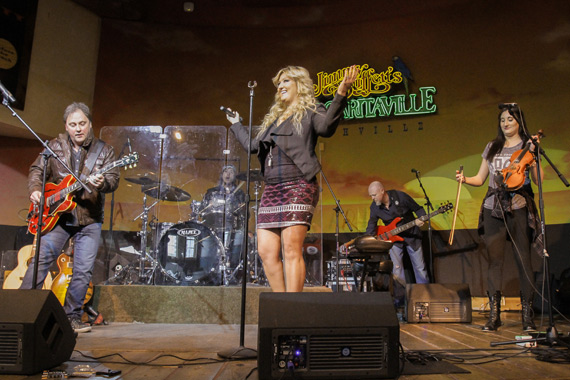 CountryBreakout Artist of the Year Erica Nicole performs with band, including producer Kent Wells on guitar