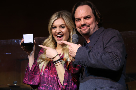 "CountryBreakout Breakout Artist and Female Artist of the Year also accepts a Challenge Coin for writing and performing her latest chart-topping hit, ""Dibs."" Pictured (L-R): Kelsea Ballerini, MusicRow's Owner/Publisher Sherod Robertson."