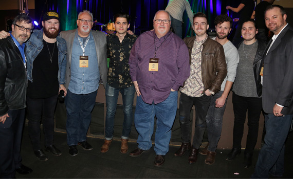 At new Arista Nashville band LANco's showcase at Nashville's 3rd & Lindsley. Pictured (L-R): Consultant Joel Raab; LANco's Jared Hampton; WQYK/Tampa OM/PD Tee Gentry; LANco's Chandler Baldwin; WKXC/Augusta OM/PD Chris O'Kelley; LANco's Brandon Lancaster, Eric Steedly, and Tripp Howell; and WQYK/Tampa MD Kevin Ebel. Photo: Alan Poizner