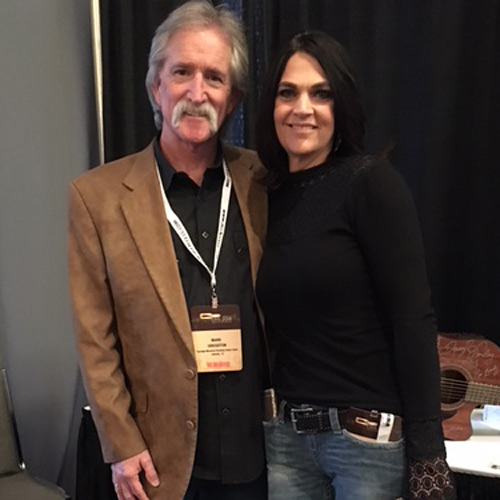 """LionEyes artist Leslie Cours Mather (R) poses with Mark Gregston (L), host of """"Parenting Today's Teens"""" after recording liners during CRS 2016."""