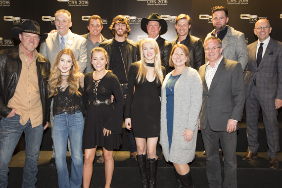 Pictured  (L-R): Trace Adkins; Maddie & Tae; Ashley Campbell; Sarah Trahern, CEO, CMA; Pete Fisher, Vice President/General Manager, Grand Ole Opry. (Back): Bill Mayne, Exec Director, CRB/CRS; Easton Corbin; Chris Janson; Tracy Lawrence; Chris Carmack;  David Nail; Charlie Morgan, President, CRB/CRS. Photo: Chris Hollo/Rachael Black