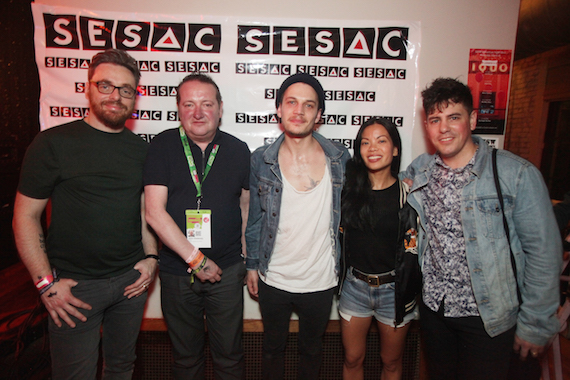 SESAC's John Sweeney (second from left) and Jamie Dominguez (second from right) hang out with members of affiliated band, The Slow Show.