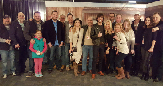 Pictured (L-R): Chris Palmer VP WAR, Kevin Herring SVP WMN, Michael Bryan PD WSIX and daughter Sophie, JR Shuman PD SIRIUS XM, Charlie Cook PD WKDF, Gator Harrison PD WUSY and wife, John Shomby PD NASH, Chris Janson, Kelly Janson, Chad Schultz WMN, Justin Cole Premiere and wife, Kimsey Kerr MD WSIX, Rod Phillips VP IHeart and wife, Tom Starr SE WAR