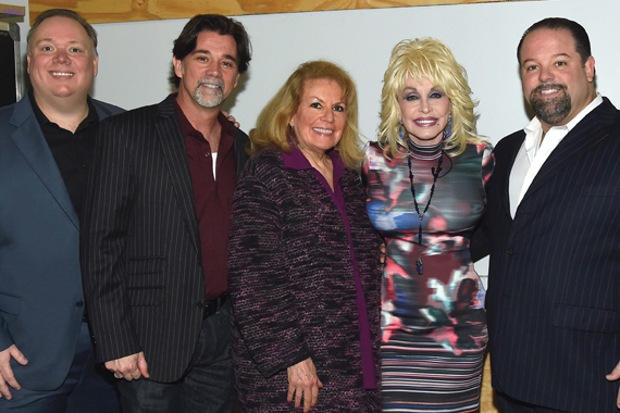 Pictured (L-R): Webster PR's Kirt Webster, APA's Steve Lassiter and Bonnie Sugarman, Parton, and CTK Mgmt's Danny Nozell. Photo: Rick Diamond