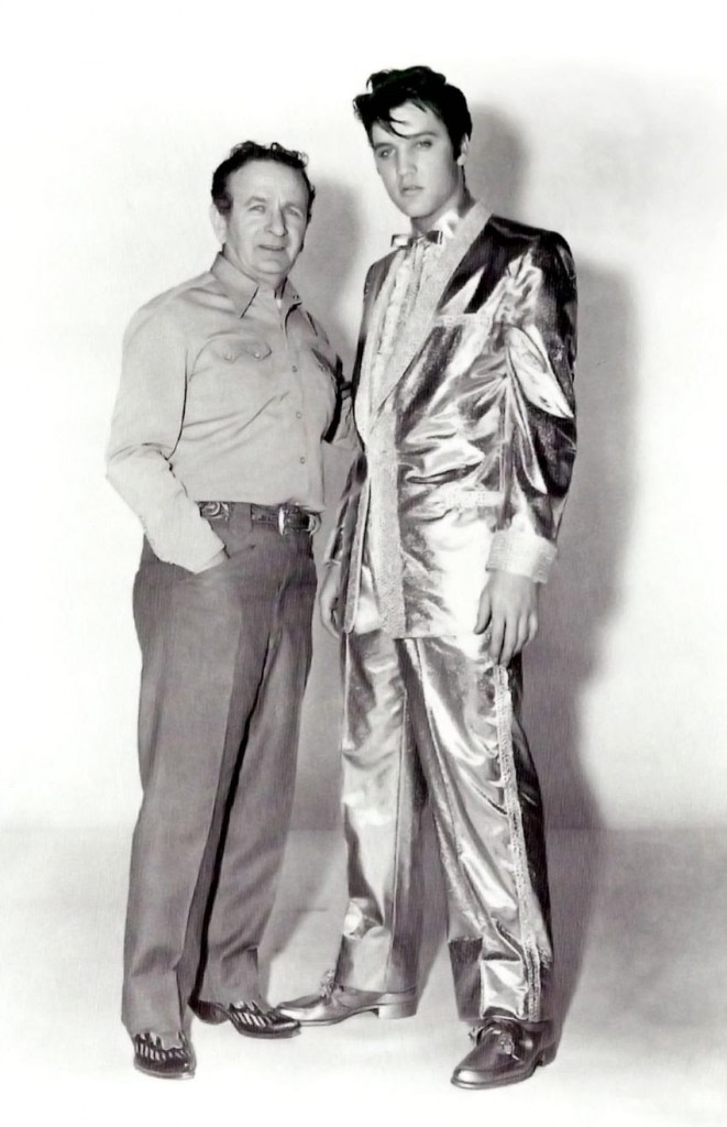 Many of Cohn's designs became signature looks for their owners. Among his most famous creations was Elvis Presley's $10,000 gold lamé suit, worn by the singer on the cover of his 50,000,000 Elvis Fans Can't Be Wrong album. Pictured here: Nudie Cohn with Elvis