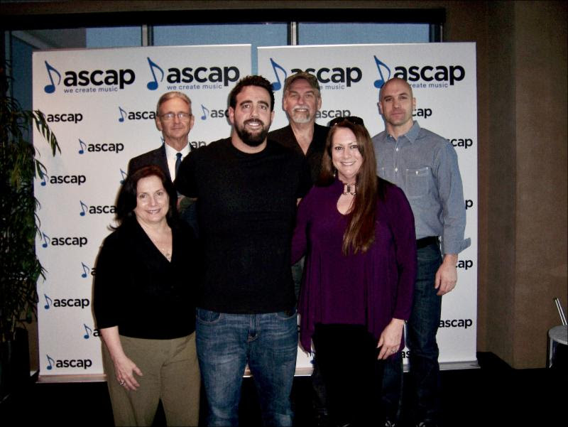 Pictured (back row, L-R):  Karl Braun, attorney; Joe Scaife, Partner, Little Extra Music; Robert Filhart, ASCAP. (front row, L-R): Denise Nichols, attorney; Rob Snyder; Lisa Ramsey-Perkins, Partner, Little Extra Music.