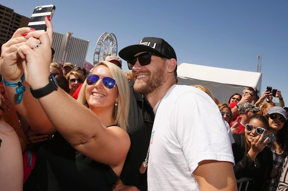 Chase Rice poses with a fan during the ACM & Cabela's Tic-Tac-Toe Archery Tournament. Photo: Getty Images/ACM