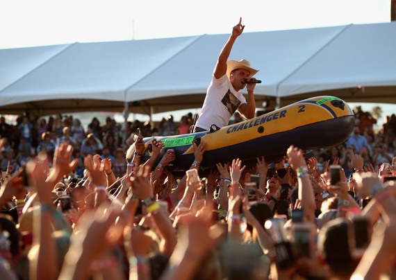 """""""LAS VEGAS, NEVADA - APRIL 02: Singer Dustin Lynch rides a raft over the crowd while performing at the 4th ACM Party for a Cause Festival at the Las Vegas Festival Grounds on April 2, 2016 in Las Vegas, Nevada. (Photo by Christopher Polk/Getty Images for ACM)"""""""