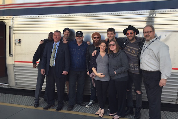 Pictured (Front row, L-R): Caitlyn Smith, Cornman's Shea Fowler. (Back row, L-R): Amtrak's James Ratliff, Amtrak's John Collins, Wilder Media's Justin Key, Songwriter Bob DiPiero, songwriter/producer Paul Moak, songwriter Rollie Gaalswyk, songwriter Ruston Kelly and Amtrak's Jerome Trahan.