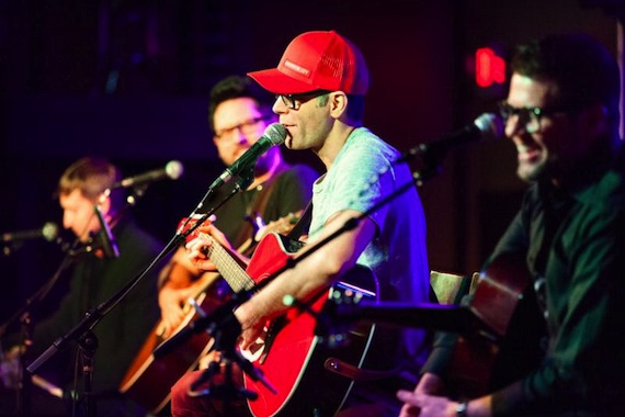 Pictured: Bobby Bones (red hat) leads the late round at 3rd & Lindsley with Ashley Gorley, Chris DeStephano and Lee Thomas Miller Photo Credit: Jason Delkou Photography