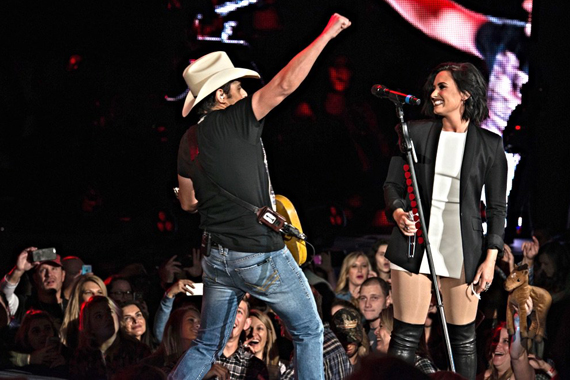 Pictured (L-R): Brad Paisley and Demi Lovato. Photo: Derek Cressman