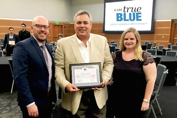 Pictured (L-R): Tim Gray, SOLID University Outreach Chair (Grayscale Entertainment Marketing); Gregory Smith, MTSU Student and Scholarship Recipient; Lisa Nolan, SOLID University Outreach Co-Chair (For the Record Entertainment)