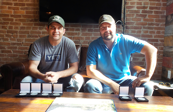 Peach Pickers members Rhett Akins and Dallas Davidson receive MusicRow Challenge Coins for penning
