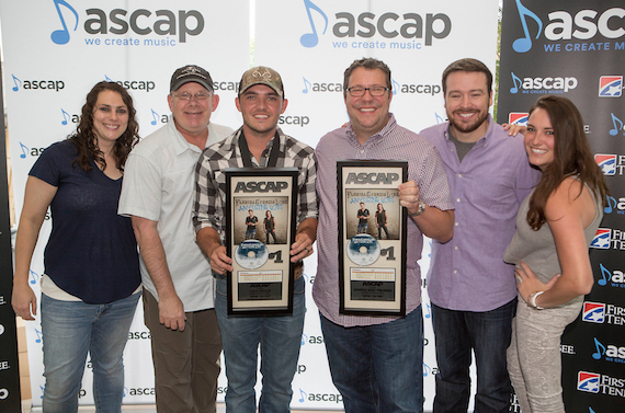 Cole Taylor poses with UMPG staff. Pictured (L-R): Missy Roberts; Ron Stuve; Cole Taylor; Kent Earls, Executive VP/GM, UMPG; Travis Gordon; Missy Roberts; and Amelia Varni