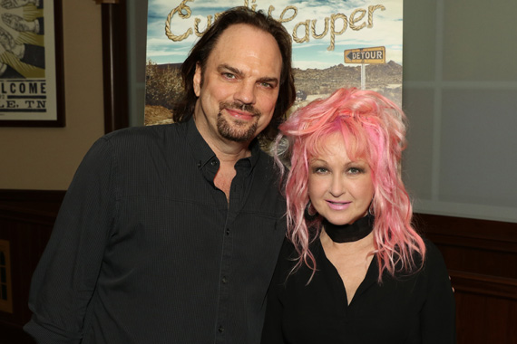 MusicRow Publisher Sherod Robertson visits with Lauper at a private industry reception following her Ryman show.