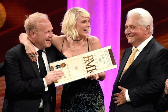 Pictured (L-R): President/CEO of Sony/ATV Music Publishing Nashville Troy Tomlinson, honoree Taylor Swift, and Sony/ATV CEO Martin Bandier pose with award onstage at The 64th Annual BMI Pop Awards. Photo: Frazer Harrison/Getty Images for BMI