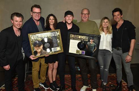 Pictured (L-R): Justin Luffman, VP Brand Management, WMN; Peter Strickland, EVP & GM, WMN; Kerri Edwards, Manager, KP Entertainment; Cole Swindell; John Esposito, President & CEO, WMN; Cris Lacy, VP A&R, WMN; Michael Carter, Producer