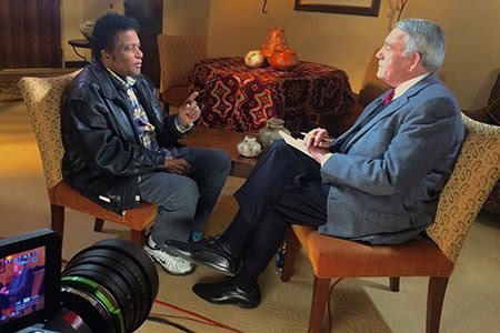 Charley Pride speaks with Dan Rather. Photo:
