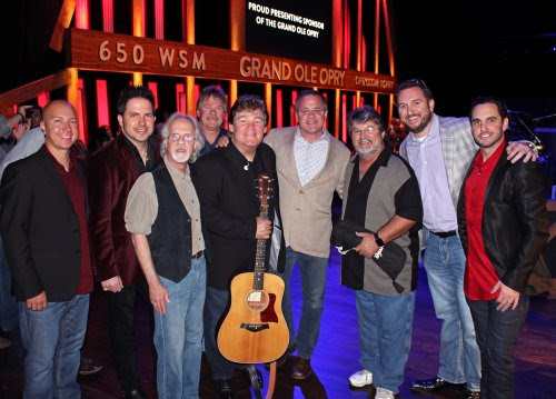 Pictured (L-R): Shenandoah's Shane Chilton, Jamie Michael, Stan Munsey, Donnie Allen, Marty Raybon, Grand Ole Opry's Pete Fisher, Shenandoah's Mike McGuire, SiriusXM's J.R. Schumann, Johnstone Entertainment's Cole Johnstone