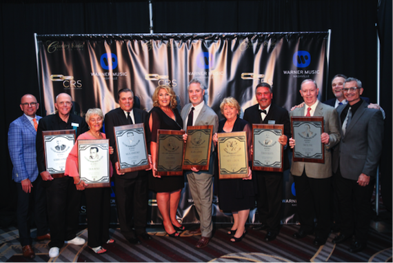 Pictured (L-R): Charlie Morgan, CRB President; Kerby Confer; Bev Reno (accepting on behalf of her late husband, Jack Reno); Mick Anselmo; Lisa Dent; Blair Garner; Dana Schuff; Tim Roberts; Jim Slone; Bill Mayne, CRB Executive Director (back), RJ Curtis, Country Radio Hall of Fame chairman. Photo: Hunter Berry