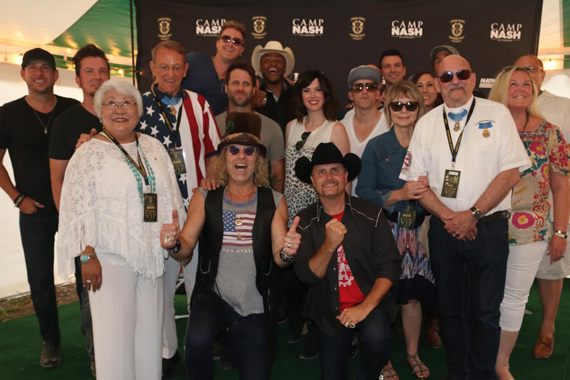 Big & Rich front center, and a cast of musicians and friends join in honoring Medal of Honor recipients recognized on Memorial Day at Camp NASH. Standing middle row, third from left: Colonel Roger Donlon, U.S. Army Special Forces ( Ret.). Standing front row beside John Rich Sgt. Gary Beikirch, U.S. Army Special Forces (Ret.).