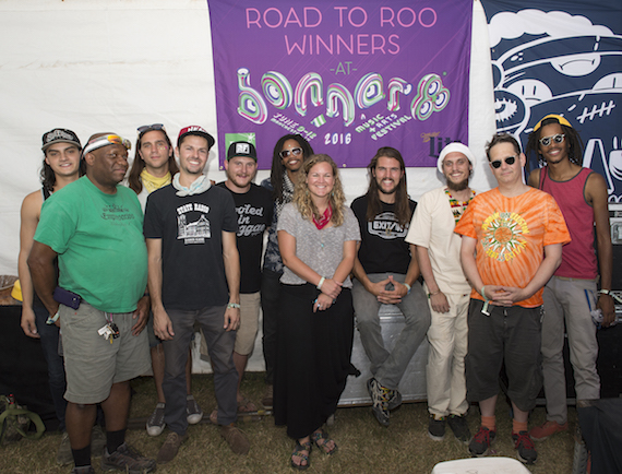 Pictured (L-R): ROAR's Marco Martinez, sound technician EL Copeland, ROAR's Dan Twiford, Troy Wiggins, Zach Fowler and Jeremyck Smith, BMI's Nina Carter, ROAR's Austin Smith and Adam Quellhorst, sound technician Shaun Washburn and ROAR's Justin Smith pose for a photo before their set as reigning champs of the BMI Road to Roo competition. Photo: Erika Goldring.)