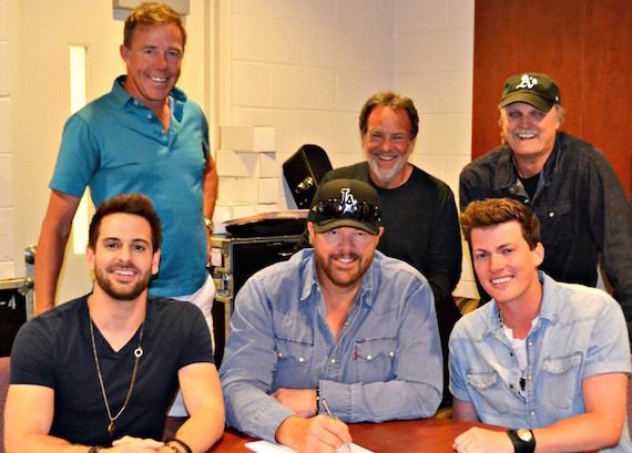 Front Row (L-R): Waterloo Revival's Cody Cooper, Toby Keith, Waterloo Revival's George Birge. Back Row (L-R): TKO Artist Management's TK Kimbrell, Show Dog Nashville General Manager George Nunes, Show Dog Nashville VP Promotion Rick Moxley