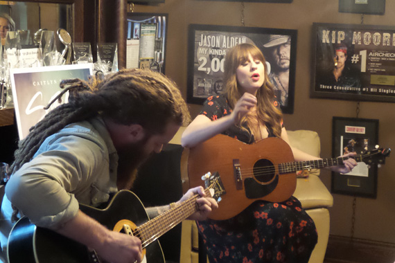 """Caitlyn Smith performs """"This Town Is Killing Me"""" at a listening party for her new EP Starfire, available July 8. Industry guests were invited to a sneak peek of the EP at her publishing firm, Cornman Music on Thursday, July 7 in Nashville."""