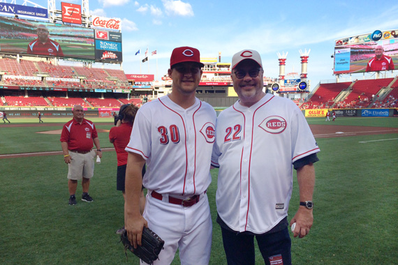 Mike Dungan, who serves as Chairman/CEO of Universal Music Group Nashville, throws the ceremonial first pitch to Reds outfielder Kyle Waldrop at the Cincinnati Reds game on Saturday, July 23, 2016.