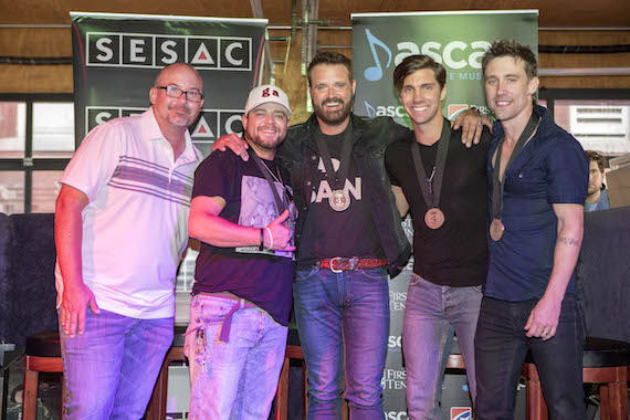 Pictured (L-R): Producer Derek George, SESAC songwriter Justin Wilson, Houser, and ASCAP songwriters John King and Matt Rogers.