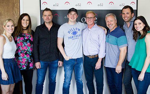 Pictured (L-R): Shellien Kinsey, ole, Creative Admin. Manager; Brooke Antonakos, RED Creative Group, VP of Creative; Jeremy Stover; Travis Denning; John Ozier, ole, VP of Creative; Mike Whelan, ole, Sr. Creative Director; Ben Strain, ole, Creative Director; Emily Mueller-Olson. ole, Creative Manager