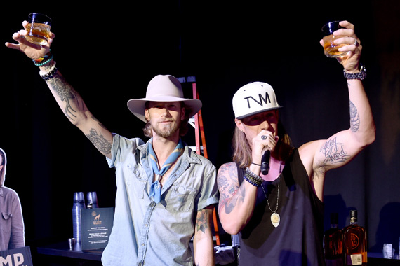 Florida Georgia Line's Brian Kelley (L) Tyler Hubbard (R) toast with their Old Camp whiskey and at OZ Arts Nashville, August 2. Photo: John Shearer/Getty Images for Pandora