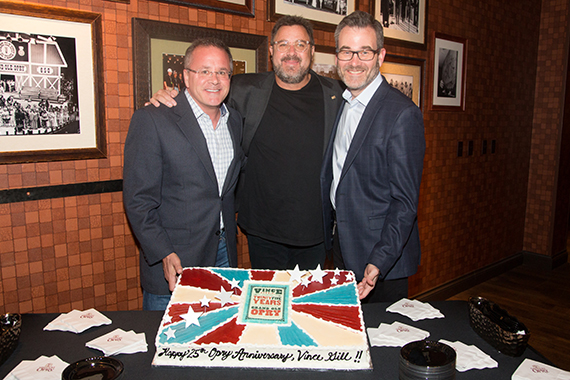Vince Gill's 25th Anniversary cake celebration backstage with Grand Ole Opry's VP/GM Pete Fisher and President Opry Entertainment Group Steve Buchanan.