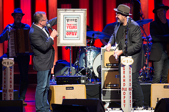 Opry VP/GM Pete Fisher presents beloved Opry member Vince Gill with a commemorative Hatch Show print for his 25th Anniversary celebration.