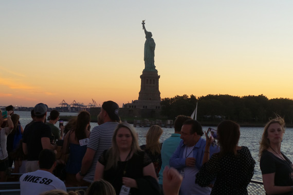 Guests take private ferry to the iconic Ellis Island.