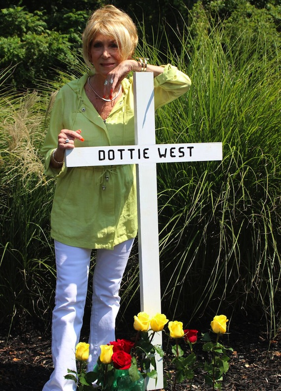 Jeannie Seely places a memorial cross on the 25th anniversary of the crash that claimed Dottie West's life.