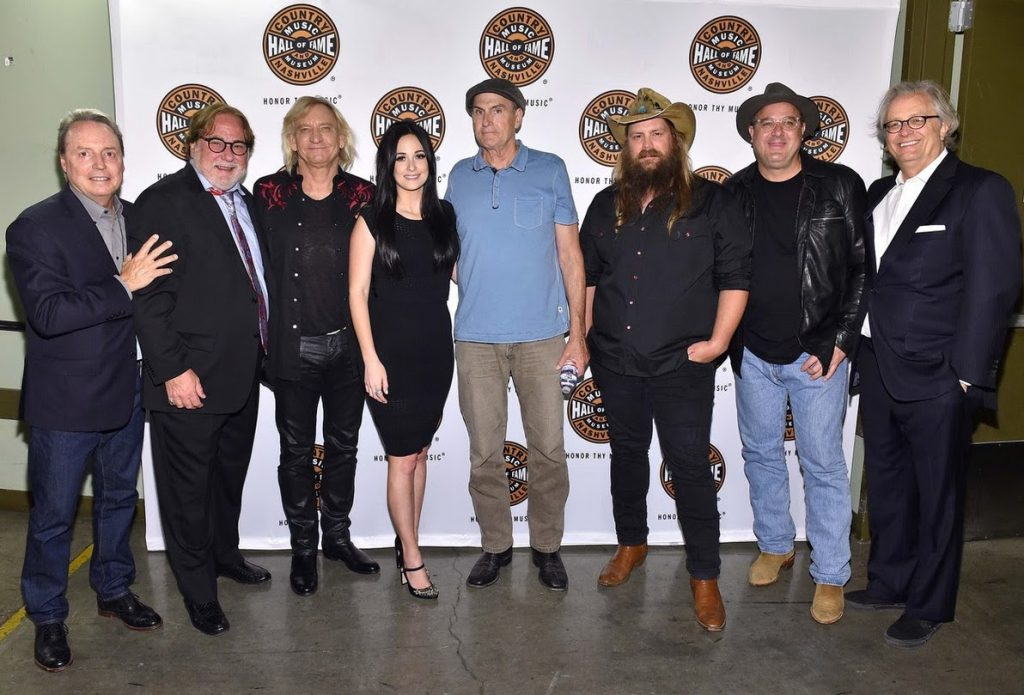 Pictured are (L-R): BMI's Jody Williams, CAA's Rod Essig, Joe Walsh, Kacey Musgraves, James Taylor, Chris Stapleton, Vince Gill and Country Music Hall of Fame and Museum CEO Kyle Young. Photo by Mike Windle, Getty Images for the Country Music Hall of Fame and Museum.
