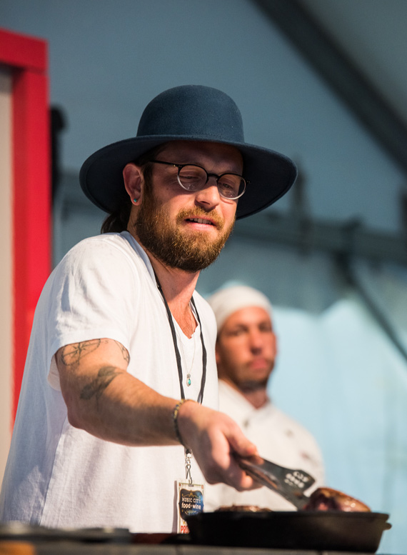 Kings of Leon's Nathan Followill lends a hand during a chef demo. Photo: Charles Reagan Hackleman