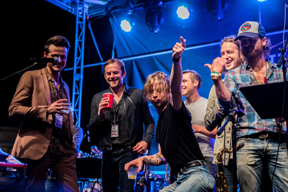 Harvest Night finale. Pictured (L-R): Kings of Leon's Jared Followill, Caleb Followill; Cage The Elephant's Matt Shultz; alongside Chris Coleman. Photo: Charles Reagan Hackleman