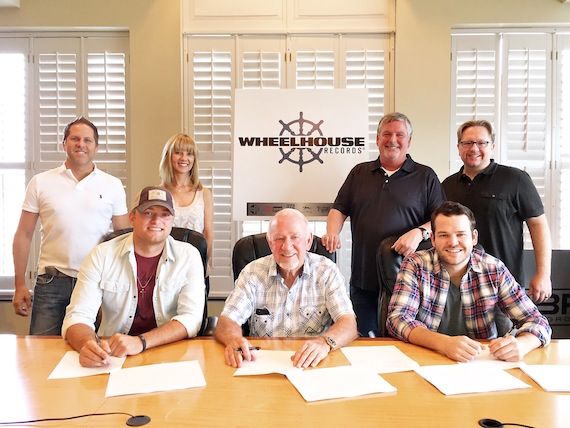 Pictured (back row, L-R): EVP of BBR Music Group Jon Loba; VP of Promotion Wheelhouse Records Teddi Bonadies; SVP of Promotion BBR Music Group Carson James; COR Entertainment's Mickey Jack Cones. (Front row, L-R): Jordan Walker; CEO/ Founder BBR Music Group Benny Brown; Johnny McGuire)