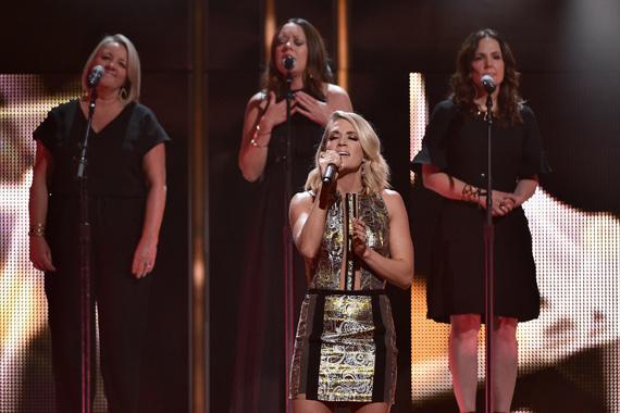 Carrie Underwood pictured in the foreground with songwriting trio The Love Junkies—Liz Rose, Hillary Lindsey and Lori McKenna—in background. Photo: John Shearer/Getty Images for CMT